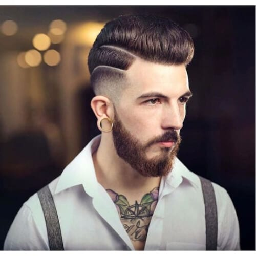 two hard parts bald fade with beard