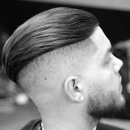 Long Textured Slicked Back Hair with Beard zero fade haircut