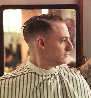 a man with a drop fade haircut
