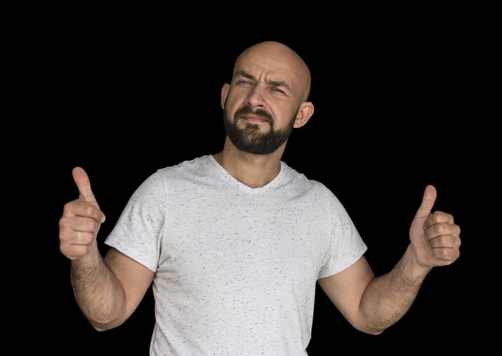 bald man giving thumbs up; mens hairstyles