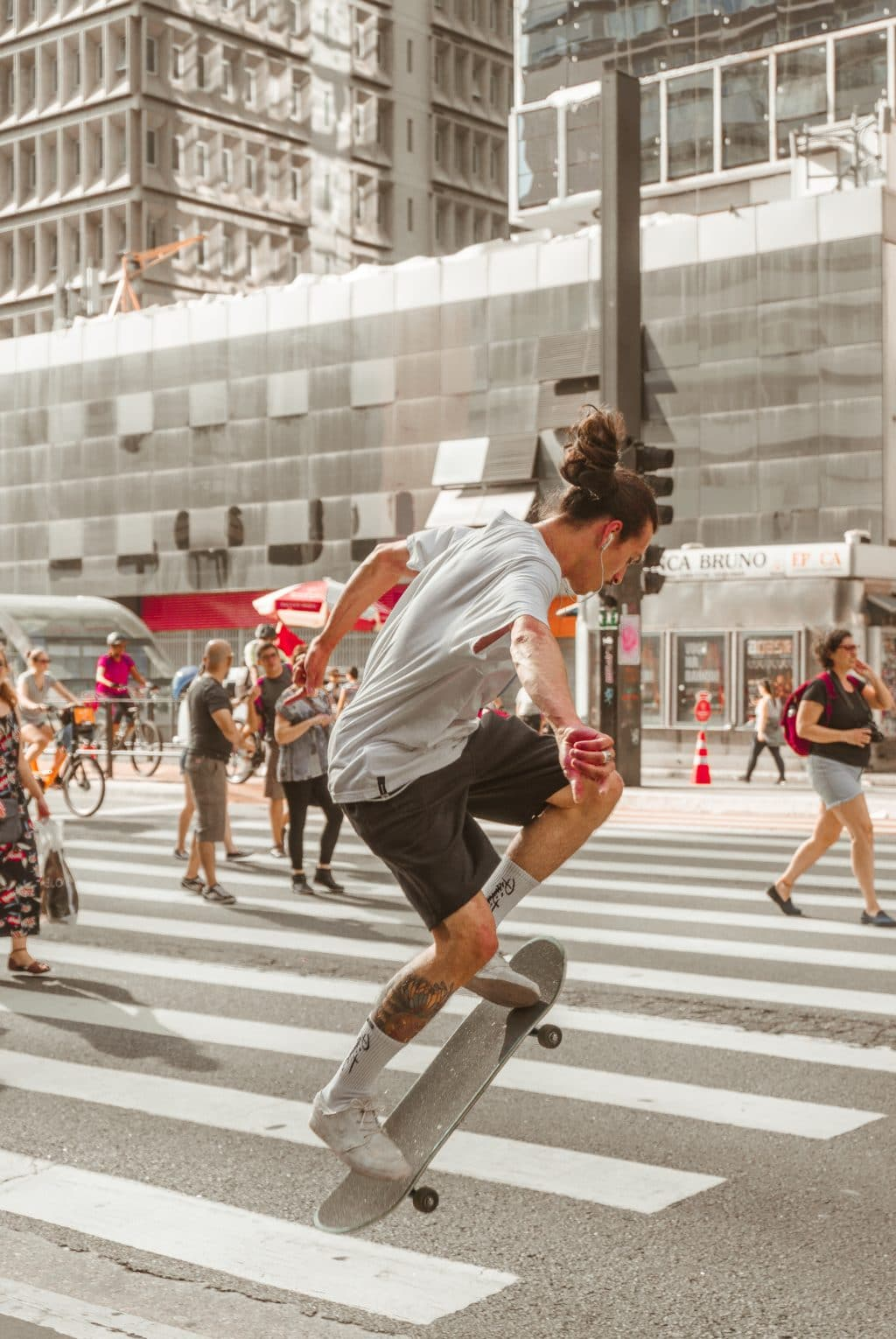 man skating on the pedestrian lane