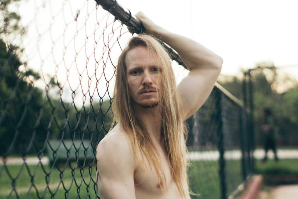 topless man with straight shoulder length hairstyle