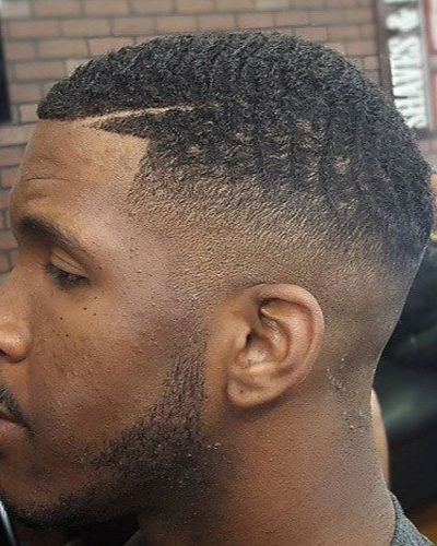 Unkempt Waves Haircut with Fade