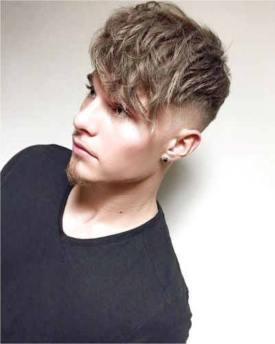 Low Shaved Sides with Long Messy Fringe and Goatee