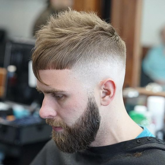 shaved sides and asymmetrical fringe for bearded man