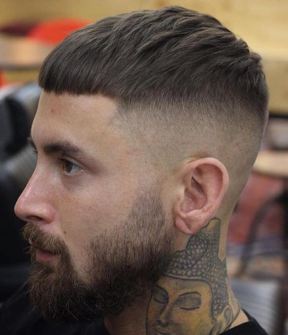 shaved sides with beard and mushroom cut
