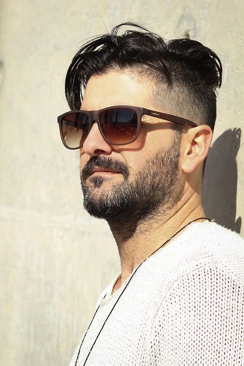 Man wearing a sunglasses is having a parted pomp hairstyle
