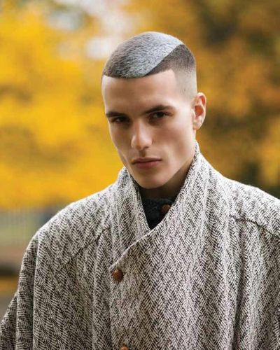 Short Hair with Diagonal White Part and Fade