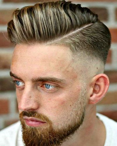 Deep Diagonal Part with Highlighted Hair and Descending High Fade with Beard