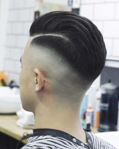 Slicked Back Part with Hard Fade and Tape Up