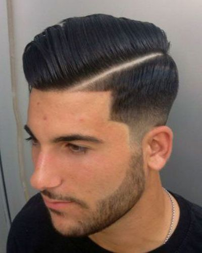 Diagonal Hard Part with Precise Taper Fade and Wide Sideburns into Short Beard