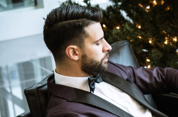 Classy guy with hard part fade