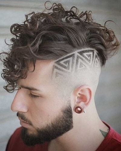 Curly Hair with Shaved Designs and Beard